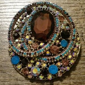 Jewelry - Gold brooch with blues and purple stones.